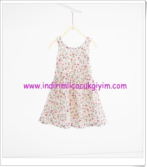 Zara kız çocuk ekru çiçek desenli elbise-56 TL