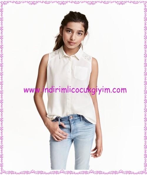 HM kız çocuk beyaz kolsuz bluz-35 TL